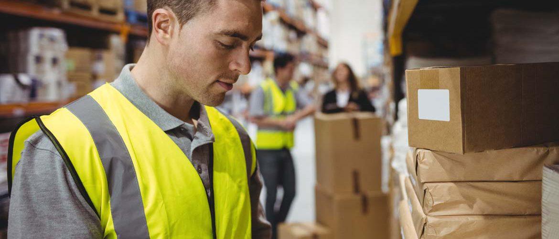 bigstock-Warehouse-worker-scanning-box-121244318.jpg